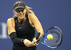 NEW YORK, Sept. 2, 2017  Maria Sharapova of Russia hits a return during the women's singles third round match against Sofia Kenin of the United States at the 2017 US Open in New York, the United States, Sept. 1, 2017. Sharapova won 2-0. (Credit Image: © Qin Lang/Xinhua via ZUMA Wire)