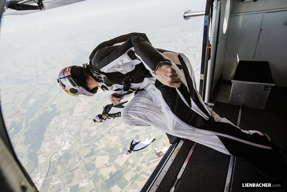 The Red Bull Skydive Team exiting their Pilatus with their wingsuits