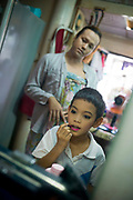 "Bangkok November 13, 2013<br /> Kafille is 6 years old. His mother had noticed since he was 3 years old, he already behaved as a little girl, showing signs of being feminine. His older brother, Aekachai, 23, is a ladyboy, and Kafille was definitely influenced by him.As her mother said: ""we can't do anything, he has to follow his heart and has to live his life the way he wants to""<br /> Bangkok 13 novembre 2013<br /> Kafille a 6 ans. Sa mère l'avait remarqué dès l'âge de 3 ans, il se comportait déjà comme une petite fille, montrant des signes de féminité. Son frère aîné, Aekachai, 23 ans, est une coccinelle, et Kafille a été définitivement influencé par lui, comme l'a dit sa mère : ""On ne peut rien faire, il doit suivre son coeur et vivre sa vie comme il le veut"""
