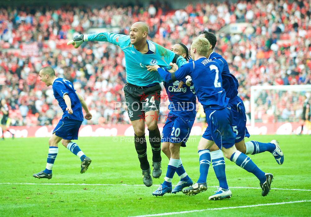 LONDON, ENGLAND - Sunday, April 19, 2009: Everton's penalty shoot-out hero goalkeeper Tim Howard celebrates with Steven Pienaar, Tony Hibbert and Joleon Lescott after beating Manchester United 4-2 on penalties during the FA Cup Semi-Final match at Wembley. (Photo by David Rawcliffe/Propaganda)