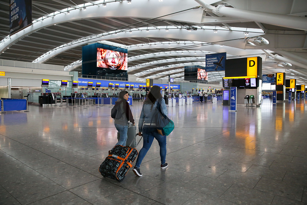 © Licensed to London News Pictures. 09/09/2019. London, UK. A couple arrives at Heathrow Terminal 5 departures  which is completely empty as tens of thousands of British Airways passengers face disruption on the first day of the two days first-ever strike staged by British Airways pilots dispute over pay. British Airways had requested its passengers that they were unlikely to travel and to make alternative arrangements prior to the strike action. Photo credit: Dinendra Haria/LNP