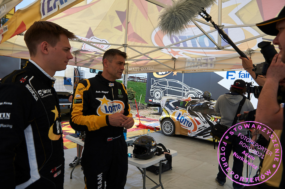 Drivers (L) Martin Kaczmarski and (R) Krzysztof Holowczyc both from Poland while tv interview during training session on rally cross track on May 19, 2015 in Slomczyn, Poland<br /> <br /> Poland, Slomczyn, May 19, 2015<br /> <br /> Picture also available in RAW (NEF) or TIFF format on special request.<br /> <br /> For editorial use only. Any commercial or promotional use requires permission.<br /> <br /> Adam Nurkiewicz declares that he has no rights to the image of people at the photographs of his authorship.<br /> <br /> Mandatory credit:<br /> Photo by &copy; Adam Nurkiewicz / Mediasport