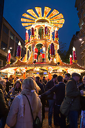 © Licensed to London News Pictures. 15/11/2014. Birmingham, West Midlands, UK. Thousands of people visited the Birmingham German Market during the first weekend of it's opening. The annual Christmas market, now in it's 14th year is the second largest German market in Europe. The German market is estimated to be worth 85 million pounds to the  Birmingham economy. The stalls which stretch right acorss the City Centre from Broad Street to the Bullring are now a mixture of German and local Brummie business's. Pictured, one of the lively German bars on New Street. Photo credit : Dave Warren/LNP