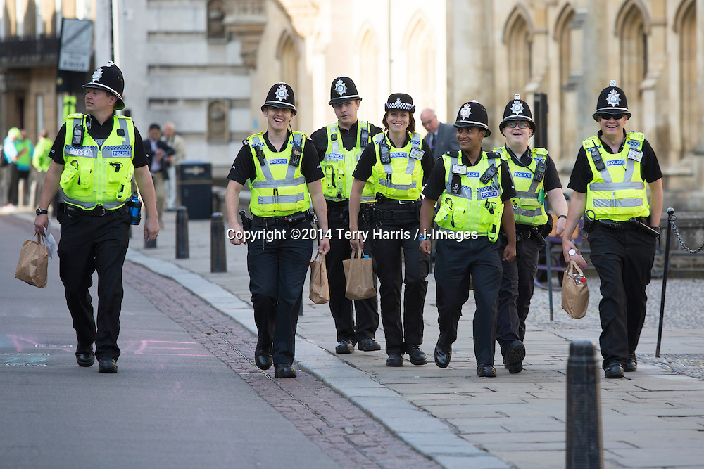 Image ©Licensed to i-Images Picture Agency. 07/07/2014. Cambridge, United Kingdom. Tour de France Stage 3 Cambridge. Police and their packed lunches. Cambridge, City Centre. Picture by Terry Harris / i-Images