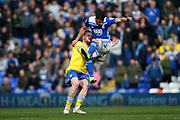 Leeds United defender Pontus Jansson (18) challenges Birmingham City defender Maxime Colin  during the EFL Sky Bet Championship match between Birmingham City and Leeds United at St Andrews, Birmingham, England on 6 April 2019.