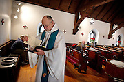 NORTH LAKE, WI — JANUARY 18, 2015:  Reverend David Couper prepares his verses before mass at St. Peter's Episcopal Church, Sunday, January 18, 2015.<br />