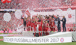 MUNICH, May 21, 2017  Bayern Munich's players and coaches celebrate during the awarding ceremony after the German Bundesliga match between Bayern Munich and SC Freiburg in Munich, Germany on May 20, 2017. Bayern Munich was awarded the Bundesliga trophy of this season after a 4-1 victory. (Credit Image: © Philippe Ruiz/Xinhua via ZUMA Wire)