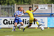 AFC Wimbledon striker Lyle Taylor (33) gets the better of Reading FC defender Paul McShane during the Pre-Season Friendly match between AFC Wimbledon and Reading at the Cherry Red Records Stadium, Kingston, England on 23 July 2016. Photo by Stuart Butcher.