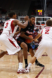 Nov 28, 2011; Stanford CA, USA;  Pacific Tigers guard Colin Beatty (center) is defended by Stanford Cardinal guard/forward Anthony Brown (3) and guard Aaron Bright (2) during the first half at Maples Pavilion.  Mandatory Credit: Jason O. Watson-US PRESSWIRE