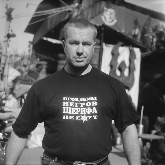 "Man's shirt reads: ""The sheriff can't be fucked by the problems of Negroes"". Moscow."
