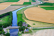 Nederland, Friesland, Gemeente Kollumerland en Nieuwkruisland, 05-08-2014; Munnekezijl, genoemd naar de sluis (zijl) in Munnikezijlsterried. Monumentale spuisluis met met de Nieuwe Friese Brug.<br /> Monumental and histotical sluice, north Netherlands.<br /> luchtfoto (toeslag op standard tarieven);<br /> aerial photo (additional fee required);<br /> copyright foto/photo Siebe Swart
