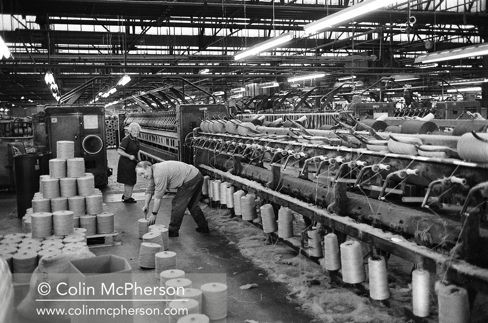 Two workers supervising a machine at Tay Spinners mill in Dundee, Scotland. This factory was the last jute spinning mill in Europe when it closed for the final time in 1998. The city of Dundee had been famous throughout history for the three 'Js' - jute, jam and journalism.
