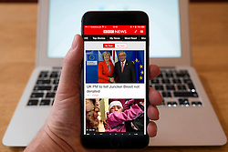 Using iPhone smartphone to display BBC News headlines on homepage