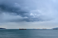 A rainstorm over the tankers at English Bay in Vancouver, British Columbia, Canada