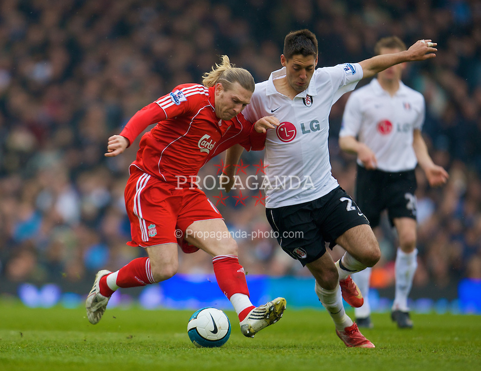 LONDON, ENGLAND - Saturday, April 19, 2008: Liverpool's Andriy Voronin against Fulham's Clint Dempsey during the Premiership match at Craven Cottage. (Photo by David Rawcliffe/Propaganda)