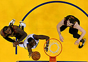 May 31, 2018; Oakland, CA, USA; Golden State Warriors forward Draymond Green (23) goes for a rebound against Cleveland Cavaliers forward LeBron James (23)  in game one of the 2018 NBA Finals at Oracle Arena.