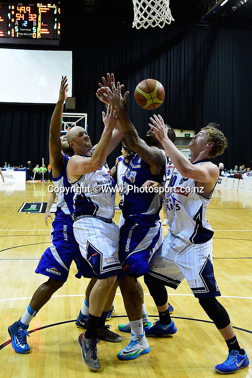 Finn Delany & Phill Jones of the Giants, Benny Anthony Jnr and Jordan Mills of the Saints jump for the ball during a NBL - Saints vs Giants semi final four basketball match at the TSB Arena in Wellington on Friday the 4th of July 2014. Photo by Marty Melville/www.Photosport.co.nz