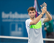 Grigor DIMITROV (BUL) With The Mens Singles Championship Runner-Up Trophy. Brisbane International Tennis Championship. Queensland Tennis Center, Tennyson, Brisbane, Queensland, Australia. 06/01/2013. Photo By Lucas Wroe