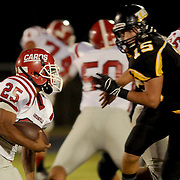 Jacksonville's Jermaine Linton rushes against Topsail's Walker Haley.