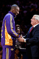 27 October 2009: Guard Kobe Bryant of the Los Angeles Lakers receives his ring and shakes the hand of commissioner David stern during the Los Angeles Lakers ring ceremony before the Lakers 99-92 victory over the LosAngeles Clippers at the STAPLES Center in Los Angeles, CA.