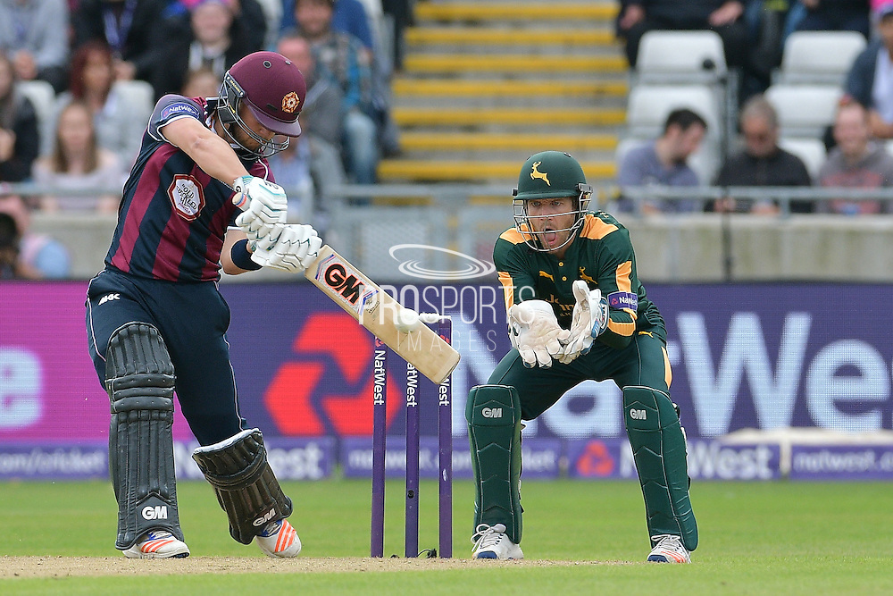 Ben Duckett drives Steven Mullaney (not shown) watched on by Chris Read during the NatWest T20 Finals Day 2016 match between Nottinghamshire County Cricket Club and Northamptonshire County Cricket Club at Edgbaston, Birmingham, United Kingdom on 20 August 2016. Photo by Simon Trafford.