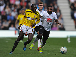 Darren Bent Derby County, battles with Brentford Toumani Diagouraga,  Derby County, Derby County v Brentford, Sky Bet Championship, IPro Stadium, Saturday 11th April 2015. Score 1-1,  (Bent 92) (Pritchard 28)<br /> Att 30,050