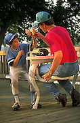 Outdoor Recreation, Father and Son Ice Cream after Baseball Game,