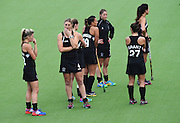 New Zealand players stand dejected after losing to England in an extra time penalty shootout during the Black Sticks Women v England Semi Final match at the Glasgow National Hockey Stadium. Glasgow Commonwealth Games 2014. Friday 1 August 2014. Scotland. Photo: Andrew Cornaga/www.Photosport.co.nz