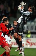 n/z.: Michal Karwan (nr5-Gornik) , bramkarz Bartosz Bialkowski (nr12-Gornik) , Polonia Warszawa (czarne-biale) - Gornik Zabrze (czerwone) 2:1 , I liga polska , 12 kolejka sezon 2004/2005 , pilka nozna , Polska , Warszawa , 13-11-2004 , fot.: Adam Nurkiewicz / mediasport.pl..Michal Karwan (nr5-Gornik) , goalkeeper Bartosz Bialkowski (nr12-Gornik) during Polish league first division soccer match in Warsaw. November 13, 2004 , Polonia Warszawa (black-white) - Gornik Zabrze (red) 2:1 , 12  round season 2004/2005 , football , Poland , Warsaw ( Photo by Adam Nurkiewicz / mediasport.pl )