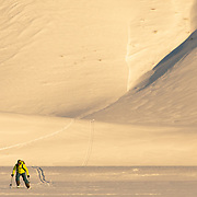 Forrest Jillson skis a sunrise line in the Teton backcountry.