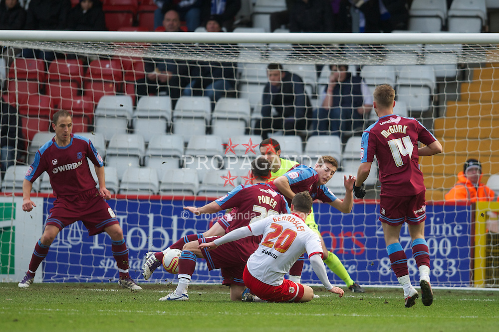 STEVENAGE, ENGLAND - Saturday, December 17, 2011: Tranmere Rovers' Ash Taylor blocks a shot from Stevenage's Chris Beardsley during the Football League One match at Broadhall Way. (Pic by David Rawcliffe/Propaganda)