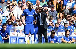 Chelsea manager Antonio Conte gives instructions to Tiemoué Bakayoko  of Chelsea as he prepares to come on the pitch.  - Mandatory by-line: Alex James/JMP - 27/08/2017 - FOOTBALL - Stamford Bridge  - London, England - Chelsea  v Everton  - Premier League