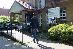 © Licensed to London News Pictures. 11/06/2015. London, UK. A voter enters a polling station in Stepney, Tower Hamlets, east London. Tower Hamlets residents go to the polls today to vote for a new Mayor of Tower Hamlets after Lutfur Rahman was removed from office for fraud in corrupt practices by an election court earlier this year. Photo credit : Vickie Flores/LNP