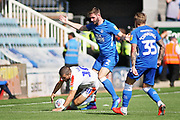 Peterborough United defender Jason Naismith (2) fouls Luton Town forward Elliot Lee (10) during the EFL Sky Bet League 1 match between Peterborough United and Luton Town at London Road, Peterborough, England on 18 August 2018.
