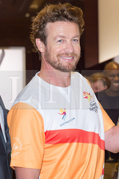 © Licensed to London News Pictures. 16/08/2017. London, UK. Longines Ambassador of Elegance Simon Baker holds The 2018 Commonwealth Games Queen's Baton at the Longines Botique in London. The Queen's Baton Relay began its journey in Buckingham Palace earlier this year and is now travelling through 71 nations or territories of the Commonwealth, covering 230'000 kilometres<br /> Photo credit: Ray Tang/LNP