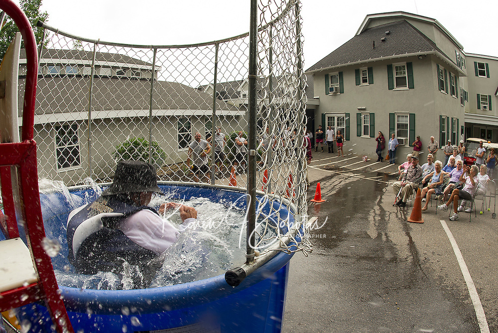 "President Timothy Martin was a good hearted, waterlogged ""dunkee"" in the dunking booth as the grounds crew took aim during the Taylor Home staff appreciation week activities on Friday afternoon.   (Karen Bobotas/for the Laconia Daily Sun)"