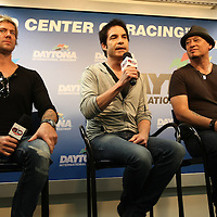 Scott Underwood, Pat Monahan and Jim Stafford,  of the Grammy award winning band Train, speak to the media prior to the start of the NASCAR Coke Zero 400 race at Daytona International Speedway in Daytona Beach, Fl., on Saturday July 7, 2012. (AP Photo/Alex Menendez) Grammy Award winning band TRAIN plays an hour long concert prior to the NASCAR Coke Zero 400 race at Daytona International Speedway in Daytona Beach, Florida on July 7, 2012.