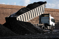SPAIN GIJON 3OCT08 - A truck unloads coal from bulk carriers in the port of Gijon, northern Spain.....jre/Photo by Jiri Rezac....© Jiri Rezac 2008....Contact: +44 (0) 7050 110 417..Mobile:  +44 (0) 7801 337 683..Office:  +44 (0) 20 8968 9635....Email:   jiri@jirirezac.com..Web:    www.jirirezac.com....All images © Jiri Rezac 2008. All rights reserved.