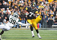 November 12, 2011: Iowa Hawkeyes wide receiver Marvin McNutt (7) gets around Michigan State Spartans safety Trenton Robinson (39) during the first half of the NCAA football game between the Michigan State Spartans and the Iowa Hawkeyes at Kinnick Stadium in Iowa City, Iowa on Saturday, November 12, 2011. Michigan State defeated Iowa 37-21.