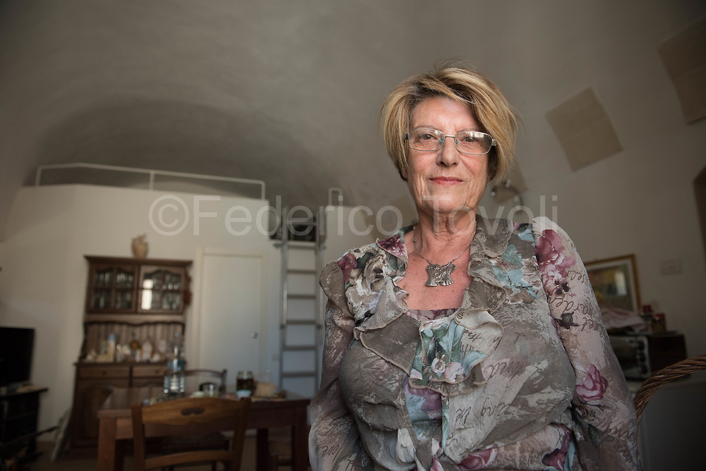 The sculptor Margherita Serra at home in a sasso in caveoso area, close to her gallery