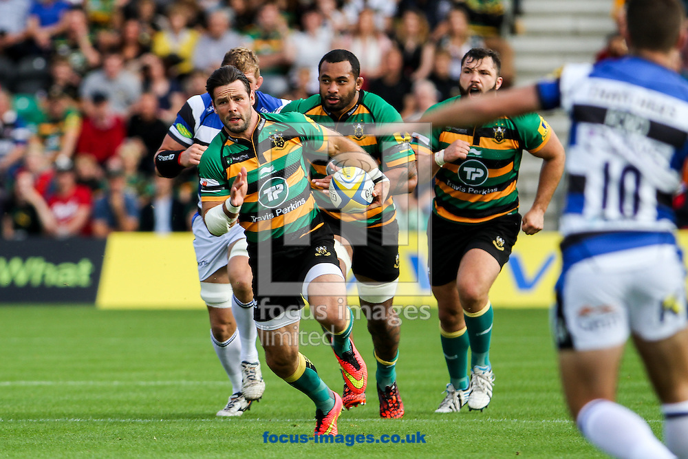 Ben Foden of Northampton Saints (left) attacking during the Aviva Premiership match at Franklin's Gardens, Northampton<br /> Picture by Andy Kearns/Focus Images Ltd 0781 864 4264<br /> 27/09/2014