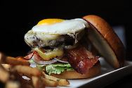 "The Local's hamburger, complete with fried egg. Wellesley resident Frank Santo recently opened his third location of ""The Local"" restaurant, on Forest St. in Wellesley, Feb. 3, 2014.<br /> Wicked Local staff photo/Kate Flock"