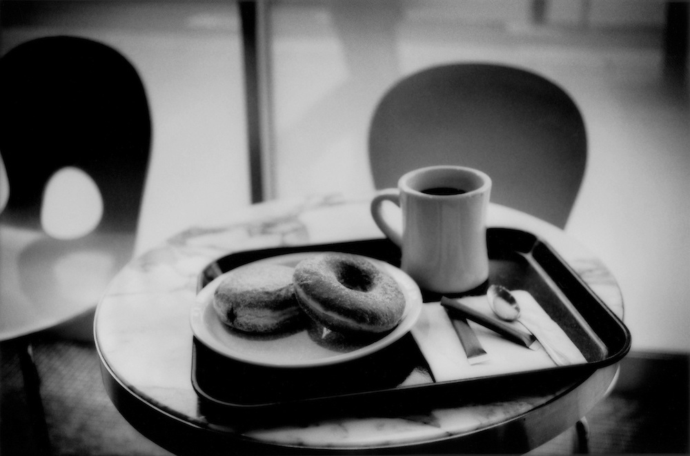 Sugar and jelly donuts, and cane sugar for coffee in a Tokyo cafe, Japan.