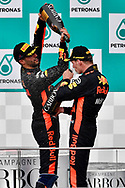 Max Verstappen of Red Bull Racing celebrates winning the Malaysian Formula One Grand Prix with team mate Daniel Ricciardo at the Sepang International Circuit, Malaysia.<br /> Picture by EXPA Pictures/Focus Images Ltd 07814482222<br /> 01/10/2017<br /> *** UK &amp; IRELAND ONLY ***<br /> <br /> EXPA-EIB-171001-0232.jpg
