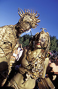 Couple dressed in gold fancy dress cyber costumes, Dance Festival, UK 1990's,