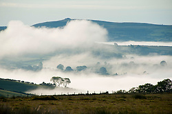© Licensed to London News Pictures. 10/06/2019. Erwood, Powys, Wales, UK. Temperatures drop dramatically to an unseasonal 4.5deg C causing a temperature inversion to form in the Wye valley. Photo credit: Graham M. Lawrence/LNP