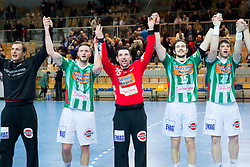 Maximillian Scher, Primoz Prost, Michael Haass and Momir Rnic of Goeppingen celebrate after the handball match between RK Cimos Koper and Frisch Auf Goeppingen (GER) in 3rd Round of EHF Cup 2012/2013, on February 23, 2013 in Arena Bonifika, Koper, Slovenia. Goeppingen defeated Cimos Koper 39-36. (Photo By Vid Ponikvar / Sportida)