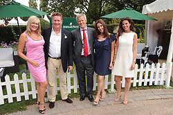 Left to right, JON & ANNIE TEEMAN, GARY MEAD CEO Audemars Piguet sponsors of the Salon Prive, CAROLINE KEMP and SABINE GROLLO at the Salon Prive - the 5th Luxury Super Car Event and Concours D'Elegance held at The Hurlingham Club, London SW6 on 21st July 2010.