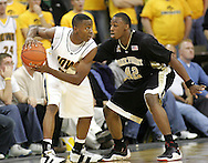 26 NOVEMBER 2007: Iowa guard Justin Johnson (24) keeps the ball away from Wake Forest guard L.D. Williams (42) in Wake Forest's 56-47 win over Iowa at Carver-Hawkeye Arena in Iowa City, Iowa on November 26, 2007.