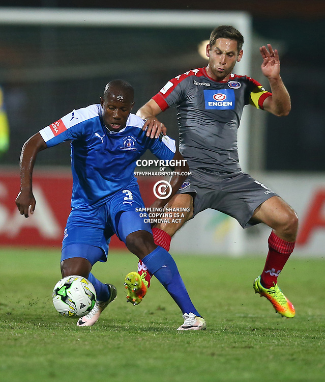 Tumelo Mogapi of Maritzburg Utd tackled by Dean Furman of SuperSport United during the 2016 Premier Soccer League match between Maritzburg Utd and SuperSport United held at the Harry Gwala Stadium in Pietermaritzburg, South Africa on the 21st September 2016<br /> <br /> Photo by:   Steve Haag / Real Time Images